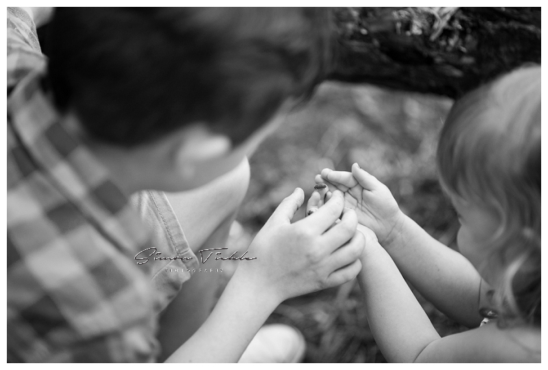 siblings inspect insect found during photoshoot