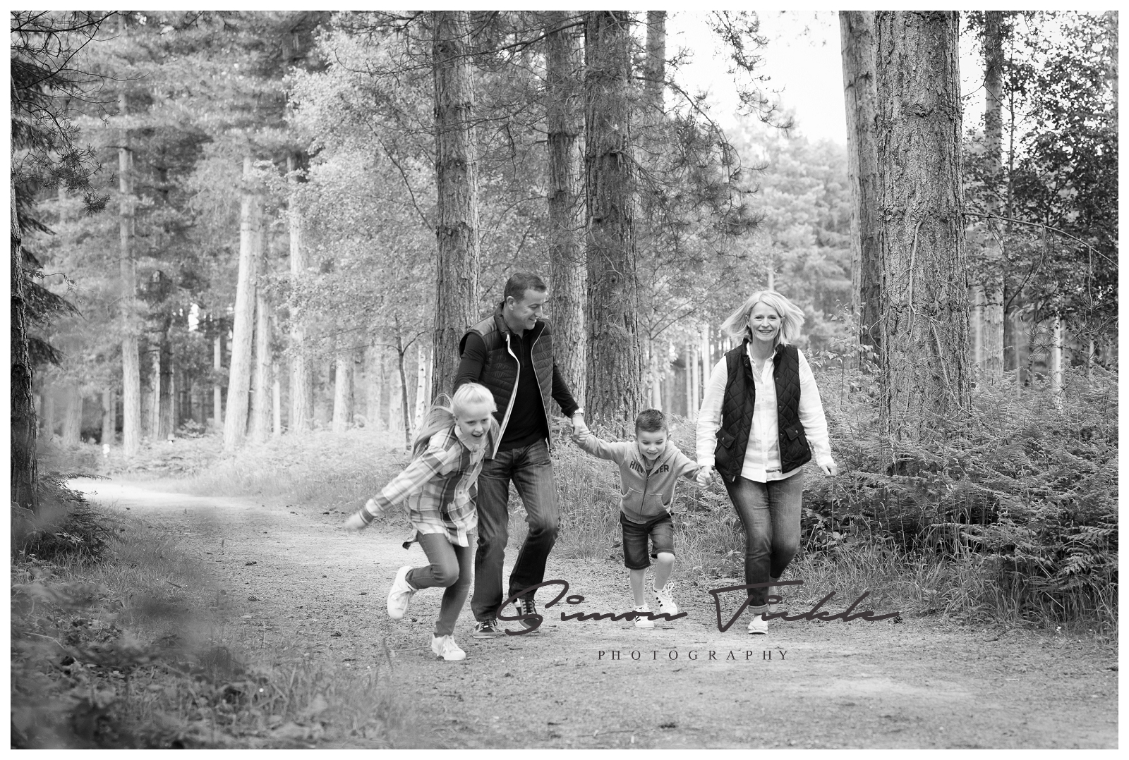family-run-through-forest-nottingham-photoshoot