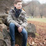 child-photo-shoot-rustic-boy-on-log
