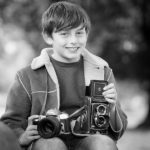 boy-holds-cameras-child-photo-shoot