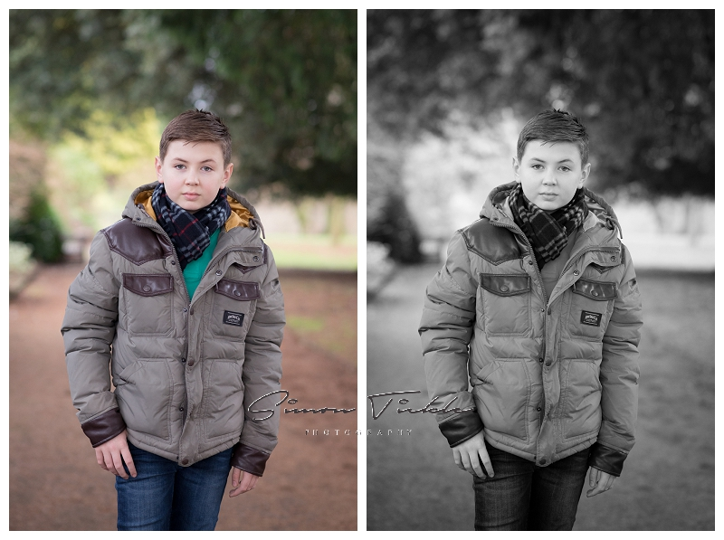 boy in jacket stands for the camera