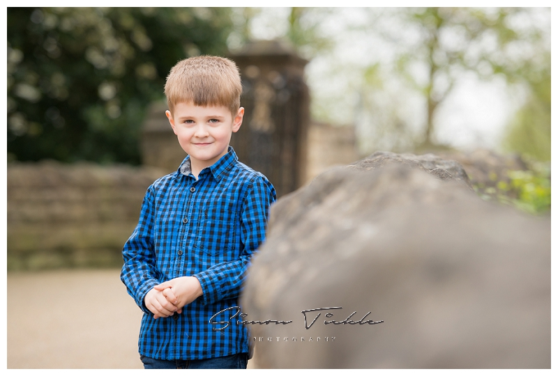 Boy in blue top stands naturally on bridge - child photo shoot mansfield